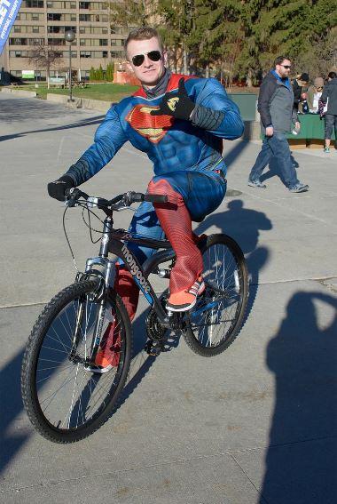 DEW volunteer dressed up for Halloween as Superman