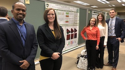 Research team with poster