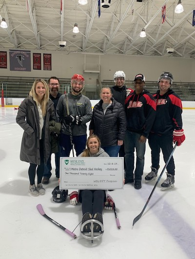 Sled hockey team presented with donation from Wayne State Physical Therapy