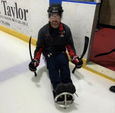 Andrew Moul at sled hockey practice