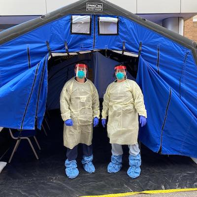 Sara Lolar and an RN staffing a COVID-19 screening tent.