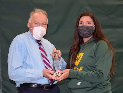 Rob Fournier presents Maddie Schmoker with an award