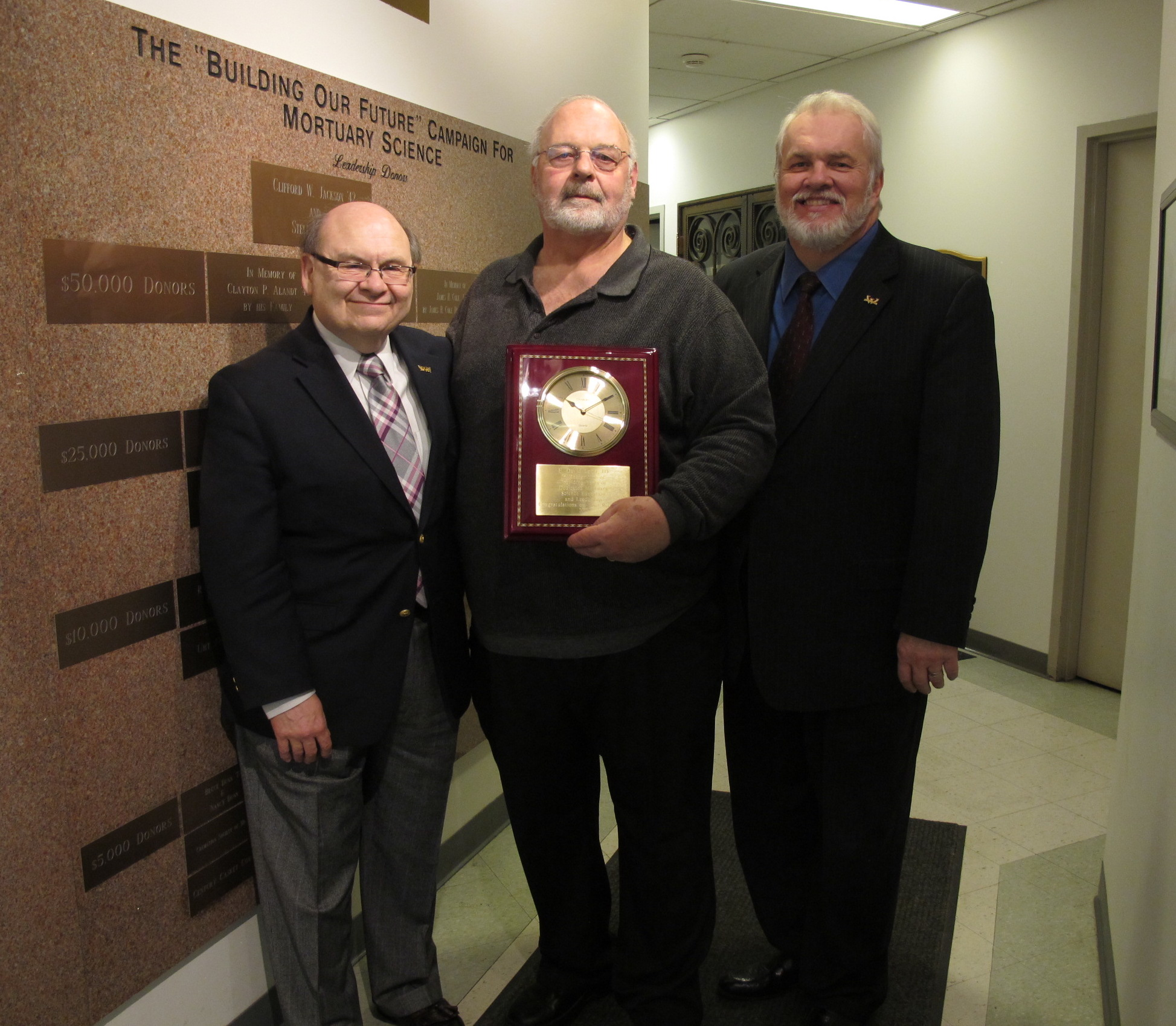 Peter Frade, David Ladd and Howard Normile at Ladd's 2013 retirement party in the Mortuary Science Building