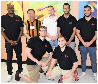 World Medical Relief CEO Dr. George Samson with Kappa Psi brothers Johnie L. Bailey, Evan Johnson, Noah Trotter, Daniel Frederick, Fadi Manuel and Hussein Safaoui.